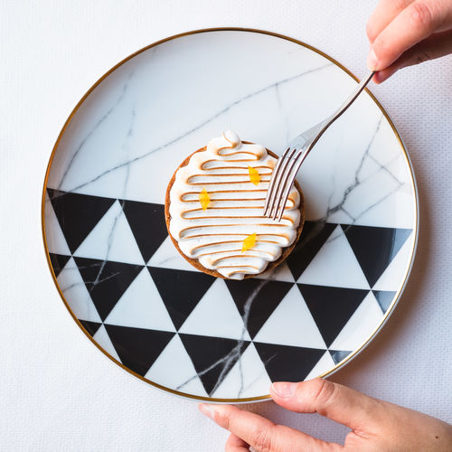 Human Hand Hand Human Body Part One Person Holding Real People Unrecognizable Person Food And Drink Body Part Finger Indoors  Human Finger Food Lifestyles Close-up Table Women Leisure Activity Freshness Geometric Shape Geometric