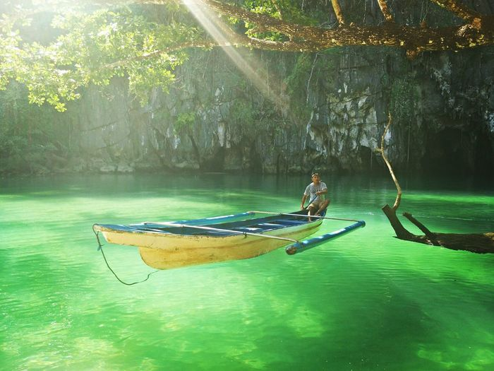 unREAL beauty of The Underground River of Puerto Princesa Palawan UNESCO World Heritage Site Undergroundriver Palawan Philippines Summer Summer Time  Summer2018 River Water Green Nature Nature Photography Photography Gondola - Traditional Boat Rowing Water Nautical Vessel Oar Tree Men Full Length Lake Rowboat Paddling Life Jacket Rafting Kayak Water Sport
