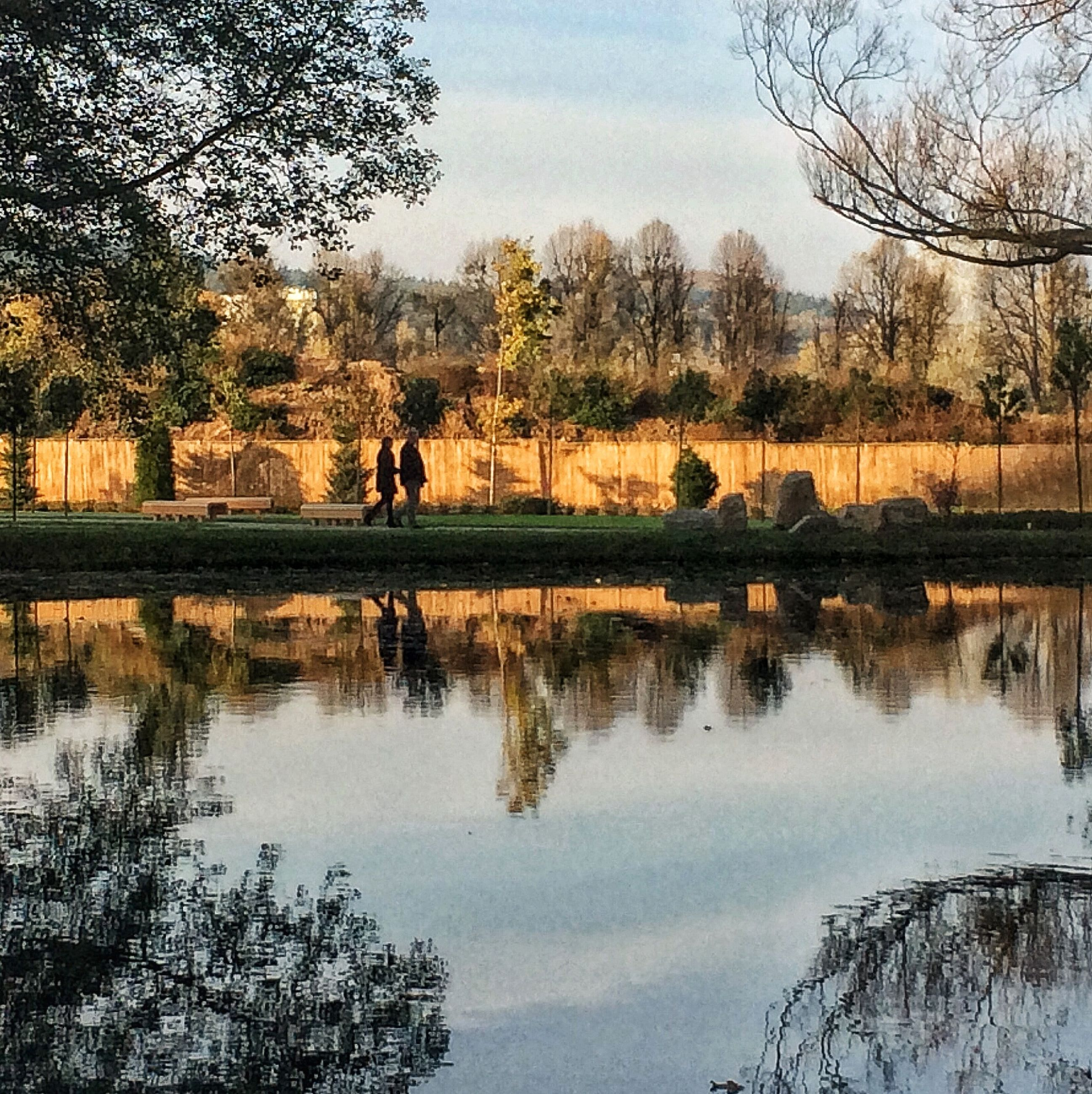tree, reflection, water, lake, bare tree, tranquility, tranquil scene, nature, lifestyles, men, leisure activity, beauty in nature, scenics, sky, river, rear view, standing, silhouette