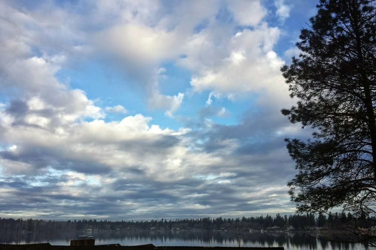 """Clouds come floting to my life, no longer to carry rain or usher storm , but to add color to my sunset sky""American Lake Clouds And Sky Clouds Collection Fluffy Clouds Tree And Sky Lake View"