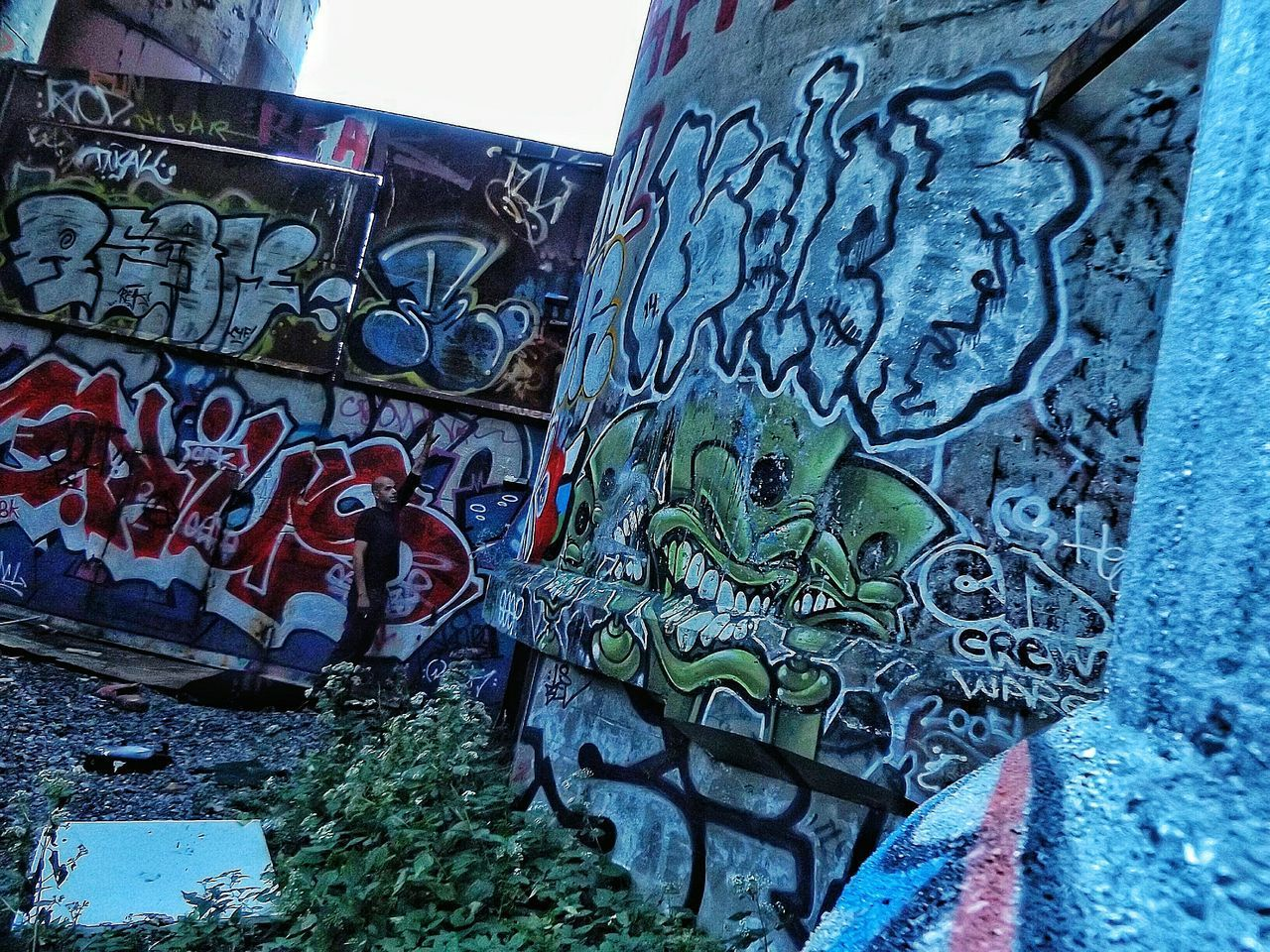 graffiti, art and craft, built structure, outdoors, text, day, architecture, metal, building exterior, street art, no people, low angle view, close-up, sky