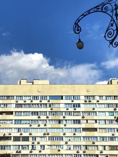 Architecture Sky Cloud - Sky Building Exterior Built Structure Low Angle View Day City Pattern Lighting Equipment Building No People Blue Sunlight Residential District Outdoors Window Communication Roof