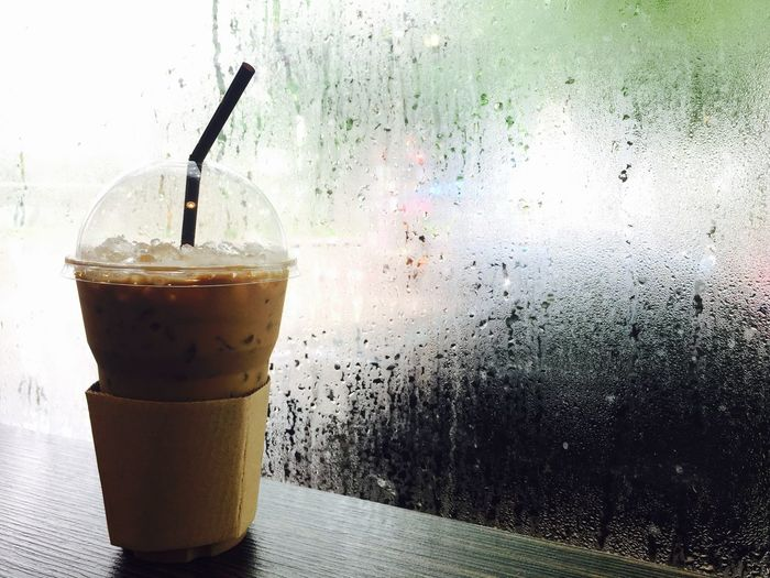 Ice coffee in rainy day Coffee - Drink Drink Food And Drink Drinking Glass Drinking Straw Indoors  Freshness Latte Cold Temperature Ice Cube Drop Rainy Days