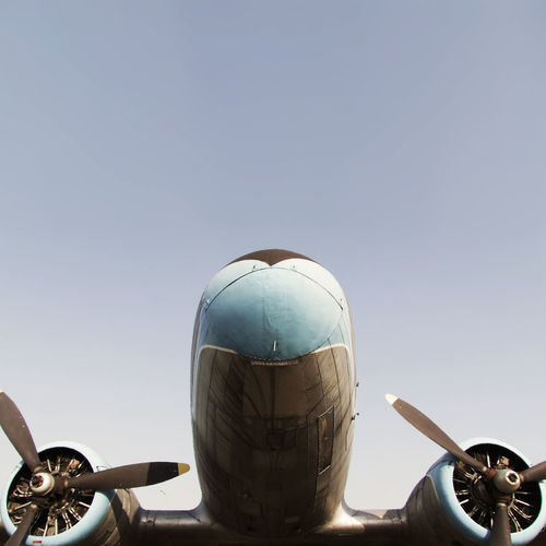 Ancient twin engine propeller plane Air Travel  Aircraft Blue Sky Budapest Cloudless Cropped Day Engine Flight Low Angle View Mode Of Transport No People Nostalgia Nostalgic  Parked Parking Part Of Plane Propeller Sky Stationary Symmetry Transportation Travel Twin Engine