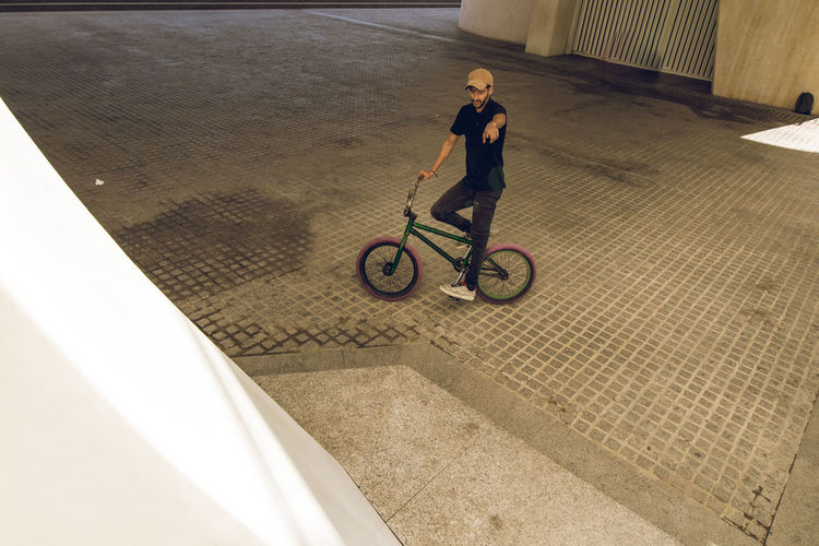 High angle view of man riding bicycle
