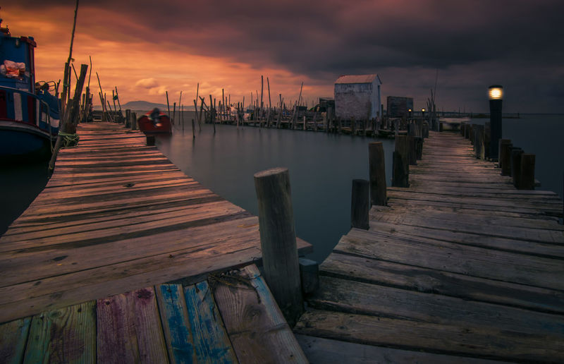 Architecture Built Structure Cloud - Sky Dusk Empty Jetty Mode Of Transportation Moored Nature Nautical Vessel No People Outdoors Pier Post Reflection Sea Sky Sunset Transportation Water Wood - Material Wood Paneling Wooden Post