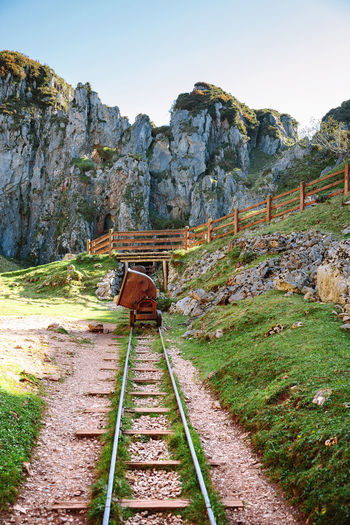 Railroad Track Against Mountains