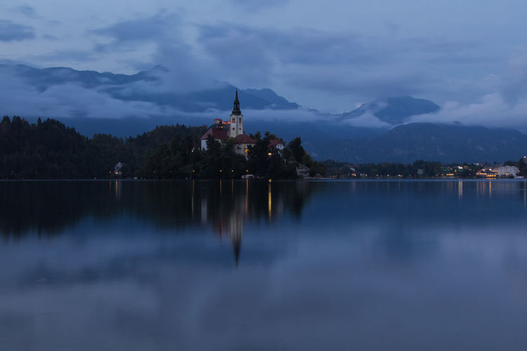 Bled Lake Slovenia Slovenia Architecture Beauty In Nature Belief Building Building Exterior Built Structure Cloud - Sky Dusk Lake Long Exposure Nature No People Outdoors Place Of Worship Reflection Religion Sky Spirituality Travel Destinations Water Waterfront