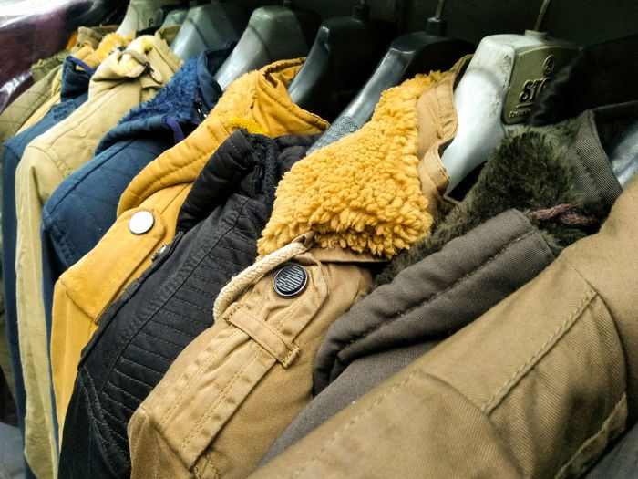 High angle view of clothes hanging on display at store