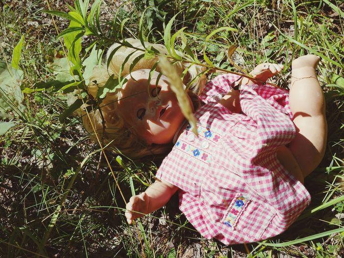 High angle view of girl lying on field