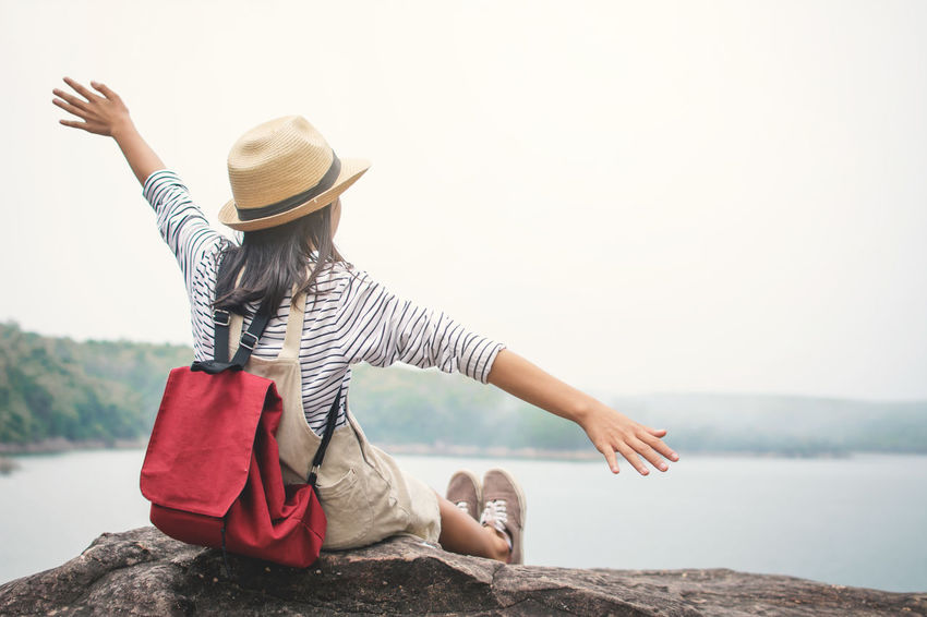 Happiness Relaxing Travel Day Girl Hat Leisure Activity Lifestyles Nature Outdoors Real People Vocation Water