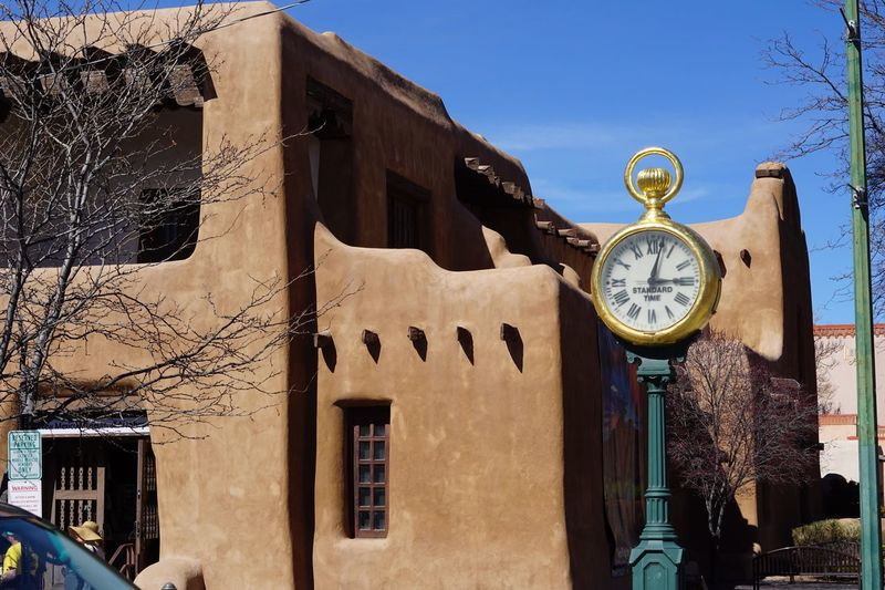 Clock Time Building Exterior Architecture Built Structure Low Angle View Day Outdoors Window No People Bare Tree Clock Face Roman Numeral Sky Clock Tower Minute Hand Tree Hour Hand