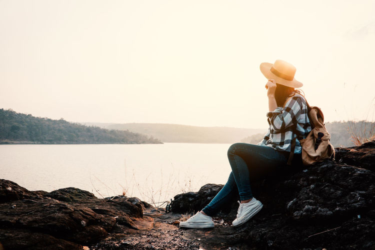 Travel Vacation Holiday Relaxing Rest Destination Nature Backpack Bag Journey Tourism Sky Lifestyles Real People One Person Rock Scenics - Nature Beauty In Nature Mountain Sitting Outdoors Sunset