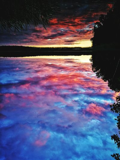 Scenic view of lake against romantic sky