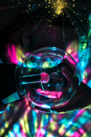 Sphere Multi Colored Human Hand Bubble Transparent Close-up Hand Reflection Illuminated One Person Holding Human Body Part Glass - Material Indoors  Crystal Ball Motion Vulnerability  Fragility Glass Nightlife