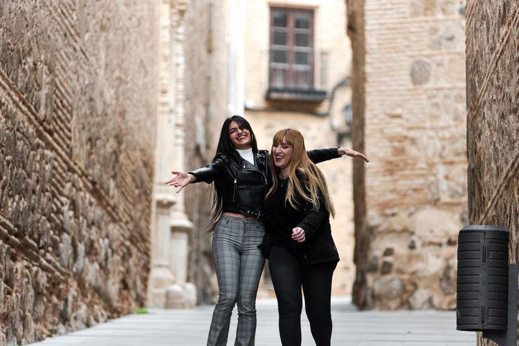 Cheerful women standing outdoors