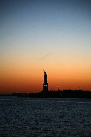 Lady Of Liberty Statue Of Liberty Statueofliberty Icon Iconic Gift Present Eiffel New York New York City New York City Life Sunset Sundown Sun Down Orange Sky Silhouette Silhoutte Photography Fresh On Eyeem  Sunset_collection Sunset Silhouettes Orange Color Orange Sky And Orange Sun
