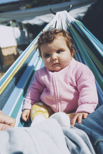 Portrait of cute baby sitting outdoors