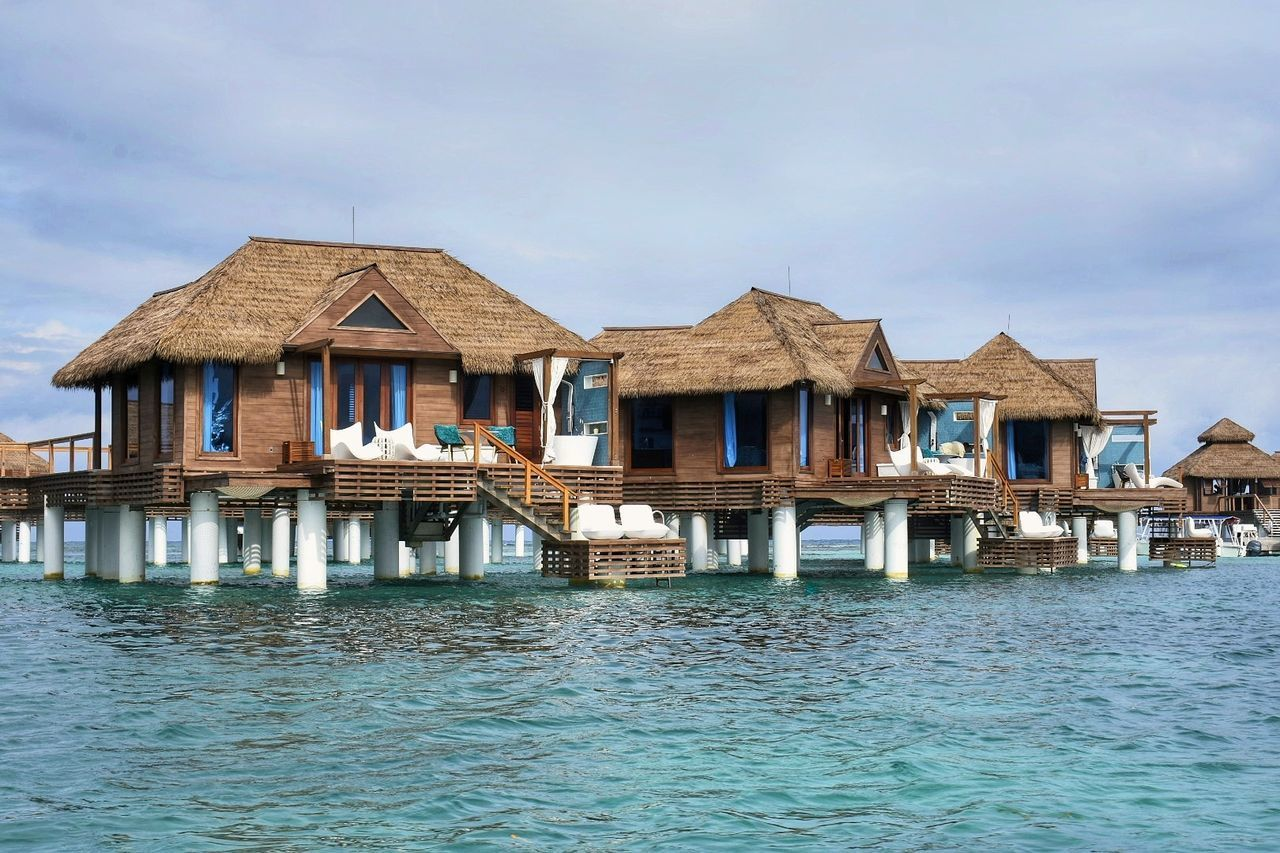 architecture, built structure, building exterior, waterfront, day, stilt, outdoors, water, sky, no people, stilt house, nature