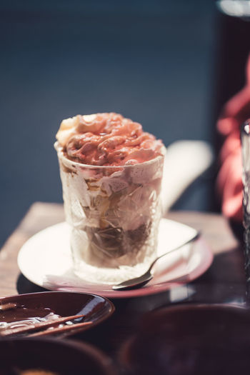 Close-up of ice cream in glass on table