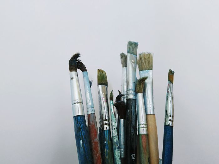 Directly above shot of paintbrushes on gray background