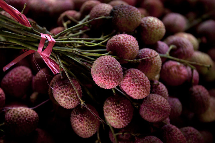 Close-up of lychees against black background