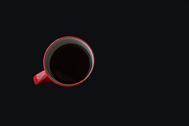 Cup Food And Drink Mug Drink Copy Space Studio Shot Refreshment Black Background Coffee Coffee Cup Indoors  Coffee - Drink Still Life Freshness Close-up No People Cut Out Red Circle Geometric Shape Tea Cup Non-alcoholic Beverage Crockery