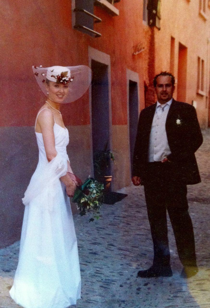 real people, formalwear, two people, full length, standing, night, men, lifestyles, indoors, bridegroom, bride, groom, people