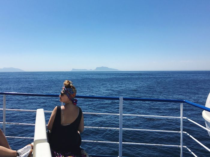 Sommergefühle Sea Horizon Over Water Water Railing Clear Sky One Person Rear View Nature Standing Blue Real People Leisure Activity Scenics Beauty In Nature Tranquil Scene Day Lifestyles Outdoors Sky Women