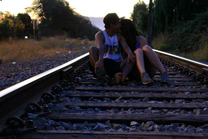 My best friends fell into each others hearts. Railroad Track Sitting Outdoors People Young Adult Love Friends Dusk Nofilter Natural Beauty Chile