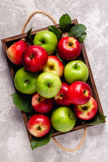High angle view of fresh apples in container
