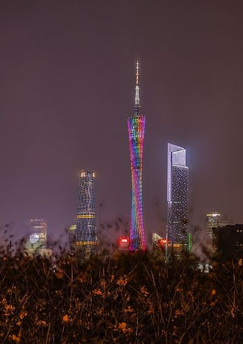 Night Tall - High Illuminated Tower No People Architecture Built Structure Building Exterior Skyscraper Outdoors Sky Modern Grass Urban Skyline City Nature 好心情(1)