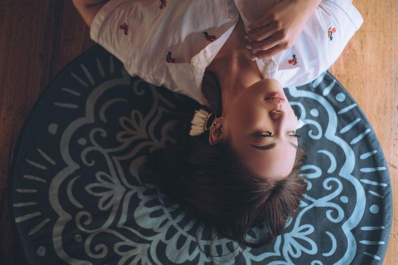 High angle portrait of woman lying on floor