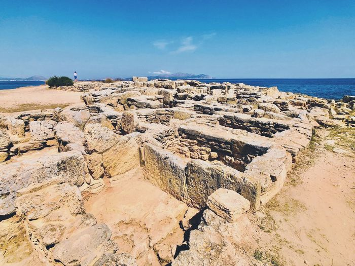 Necropolis Mallorca Vacation Archaeology Archaeological Sites EyeEm Selects Beach Water Sky Land Sea Horizon Over Water Nature Beauty In Nature Day Sand Tranquility Outdoors Idyllic Tranquil Scene Horizon Scenics - Nature Blue Sunlight Summer