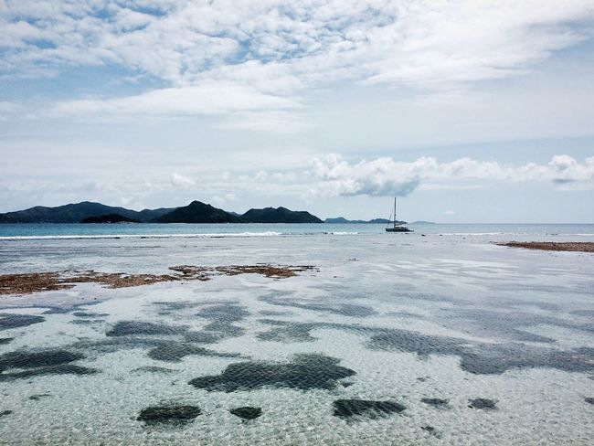 Sea Sky Water Nature Scenics Beauty In Nature Cloud - Sky Beach Tranquility Tranquil Scene Outdoors No People Day Nautical Vessel Horizon Over Water Sand Seychelles La Digue