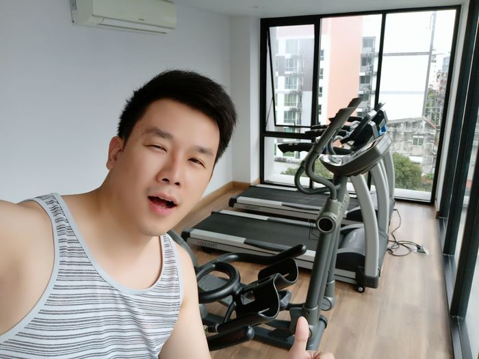 Portrait of man standing in gym