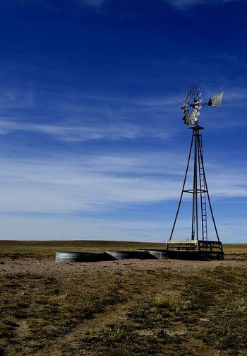 Windmill with three stock tanks