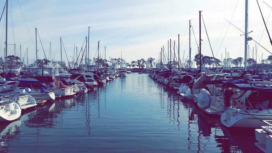 Nautical Vessel Transportation Moored Boat Harbor Reflection Mode Of Transport Mast Sky Sailboat Cloud In A Row Waterfront Water Diminishing Perspective Large Group Of Objects Day Marina Sea Abundance