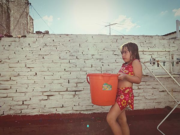 Child Children Only One Girl Only One Person Childhood Holding Sky Standing Outdoors People Day Playing With Water Summer Hot Weather