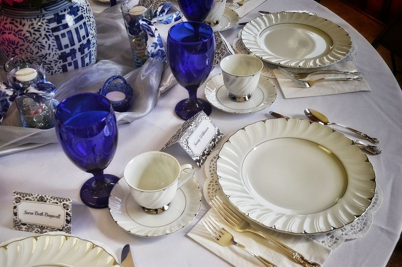 Close-up of plates and glasses on dining table