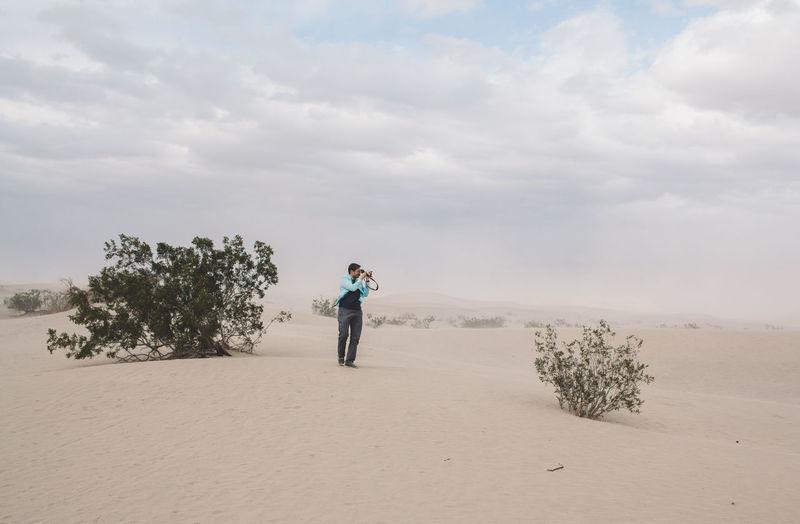 Full Length Of Man Photographing In Desert