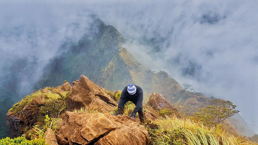 High Angle View Of Hiker Hiking On Mountain