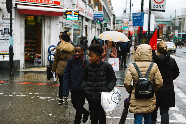 London British Culture London Street Uk United Kingdom City Architecture City Life Real People Walking Transportation Wet Women Adult Group Of People Men Rain Umbrella People Winter Lifestyles Building Exterior Rear View Warm Clothing City Street Rainy Season Outdoors