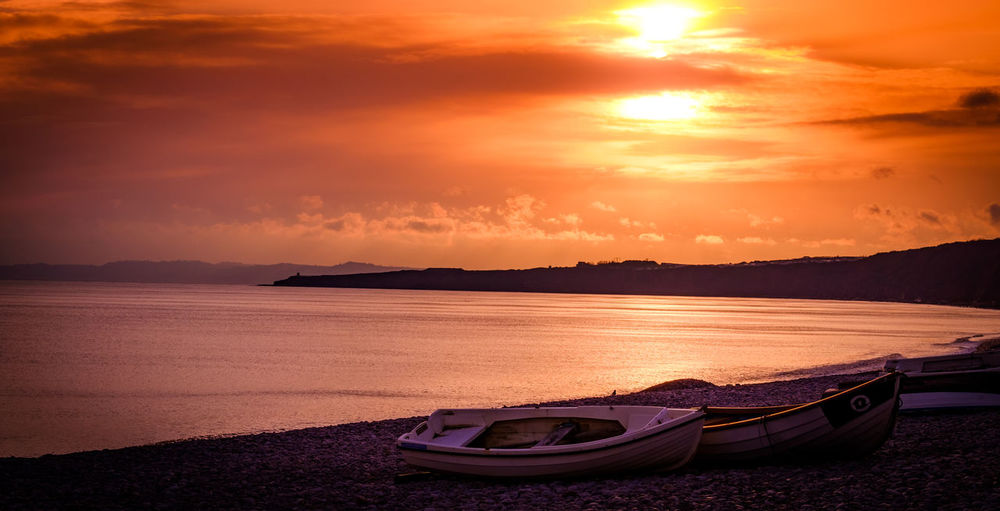 Beach Beauty In Nature Horizon Over Water Nature Nautical Vessel No People Orange Color Sun Sunset Tranquil Scene Water