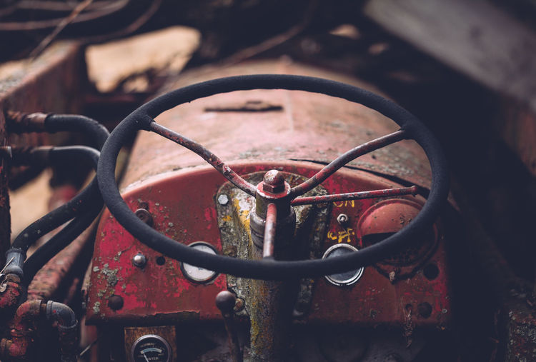 Close-up of abandoned tractor