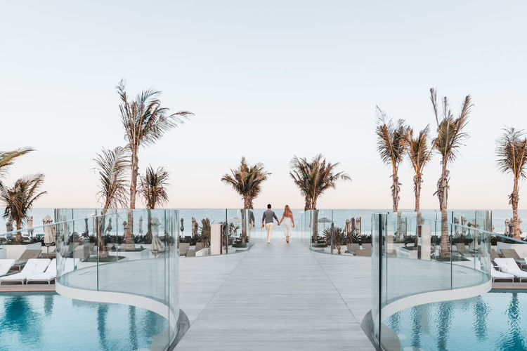 Panoramic view of swimming pool against clear sky
