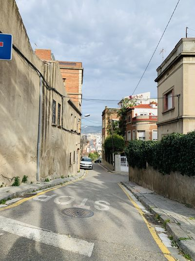 Surface level of road by buildings in city