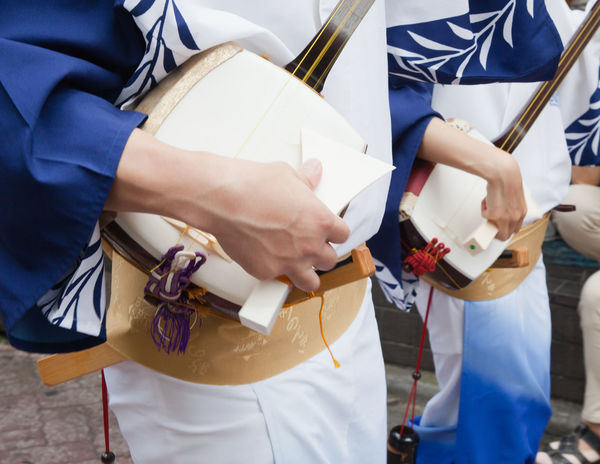 Awa Odori Celebration Festival Focus On Foreground Holding Instruments Japan Leisure Activity Lifestyles M Music Outdoors Shamisen Street Performer Summer Festival Summer Time  Traditions