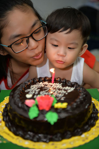 Birthday Birthday Cake Birthday Cake Birthday Candles Birthday Party Blowing Candles Burning Cake Cakes Candle Celebrant Celebrants Celebration Child Close-up Eyeem Philippines Happiness Life Events People Siblings Wish Wishes Food Stories