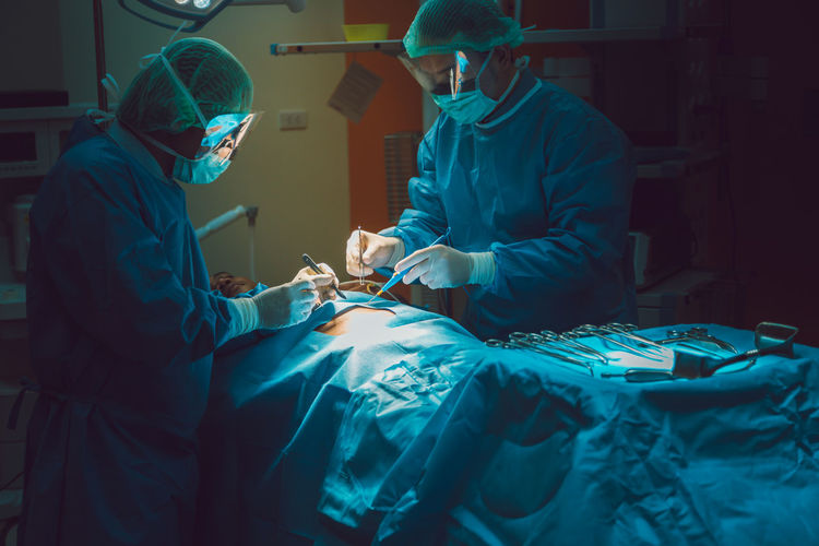 Doctors Doing Surgery Of Patient In Operating Room